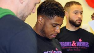 Cardiff City player Kadeem Harris (centre) was one of many stars who toured the wards