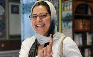 A woman residing in the US shows ink on her finger after casting her vote for the Iran Presidential election on May 19, 2017 at a polling station at Manassas Mosque in Manassas, Virginia
