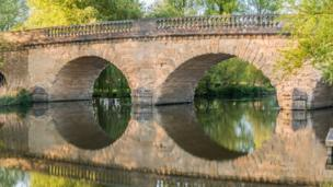 Swinford Toll Bridge reflection, five pence to cross, more for multiple axles