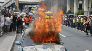 """A dilapidated car is set on fire to simulate damage from a strong earthquake during a Metro-wide shake drill to test various government agencies"""" response in the event of a real one Wednesday, June 22, 2016"""