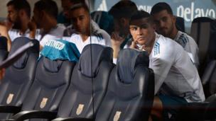 Ronaldo and teammates sitting on bench