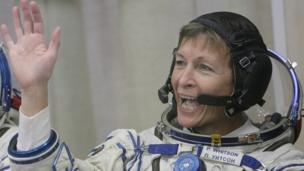 Peggy Whitson waving