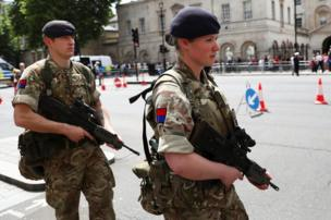 Soldiers walk through central London,