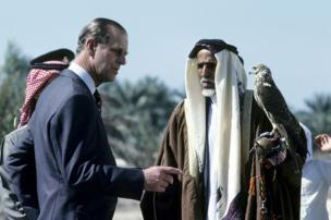 Prince Philip, Duke of Edinburgh looks at a hawk during a visit to Bahrain in February 1979 in Manama, Bahrain.