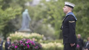 A sailor stands to mark the silence in memory of the Somme