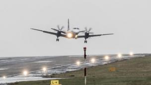 Plane lands at Leeds Bradford Airport in heavy wind.