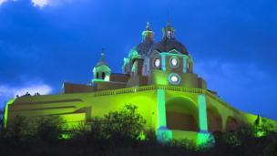 Iglesia de Nuestra Señora De Los Remedios, Cholula, Mexico joins in the 'global greening' for Saint Patrick's Day festivities.