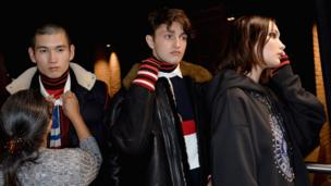 Anwar Hadid (centre) with sister Bella and another male model