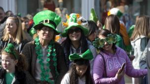 Crowds getting into the spirit of St Patrick's Day during the Belfast parade