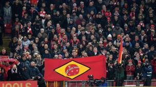 Liverpool fans in the UK hold a Brazil-inspired flag