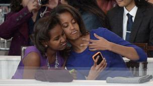 Obama daughters take a selfie at inaugural parade, 2013