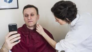 Opposition leader Alexei Navalny, barred from taking part in the election, has his make-up applied before taking part in a live broadcast in Moscow on 18 March 2018