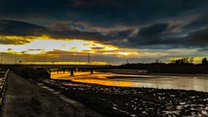 Richard Moult's shot of the sun setting behind Loughor bridge