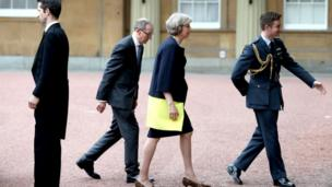 Theresa May arriving at Buckingham Palace with her husband Philip May