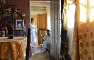 Two people inside a house in South Africa