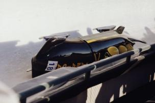 A bobsled turned over onto its side.