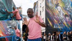 Idris Elba with Star Trek Beyond mural in Clerkenwell, London