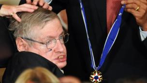 Stephen Hawking receives the Presidential Medal of Freedom from US President Barack Obama during a ceremony in the East Room at the White House on August 12, 2009.