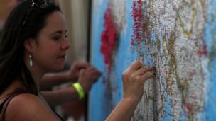A visitor puts a pin on map to show where she is visiting from during the Wyoming Eclipse Festival on August 20, 2017 in Casper, Wyoming. Thousands of people have descended on Casper, Wyoming to see the solar eclipse in the path of totality as it passes over the state on August 21.