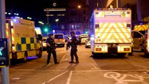 Police and other emergency services are seen at the scene outside the Manchester Arena.