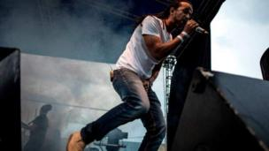 French reggae group Dub Incorporation singer Aurelien Zohou perform during di Amani Festival wey dem do to promote peace and culture.