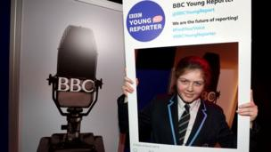 A Young Reporter in a selfie frame