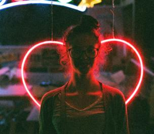 in_pictures Woman in front of heart sign
