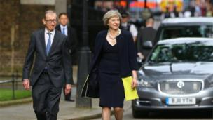 Mrs May with her husband Philip arriving at Downing Street