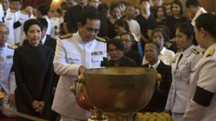Thai Prime Minister Prayuth Chan-ocha attends a bathing ceremony for the former Thai king