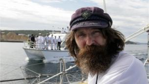 Fedor Konyukhov on board his yacht as he pilots it into the Australian port of Albany on 7 May 2008, with another small boat in the background, with all its crew on deck.