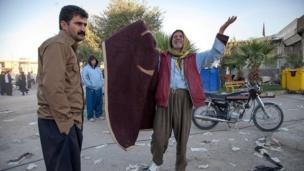 Residents are pictured distressed in the street in Sarpol-e Zahab county in Kermanshah