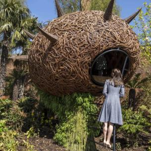 """The Duchess of Cambridge looks at a """"Dragons nest"""" play area as she views Hampton Court""""s Magic Garden"""