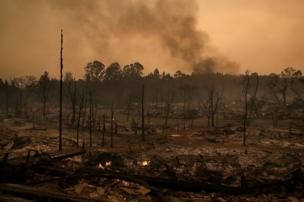 Smoke billows from a neighbourhood that was destroyed by a fast-moving wild fire in Santa Rosa, California, 9 October