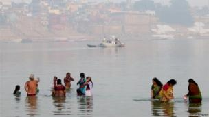 Early morning in Varanasi as people perform their daily purifying rituals.