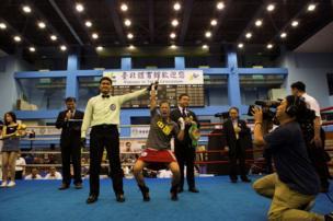 Huang Wensi celebrates her victory