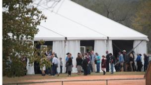 Worshipers attend service at the temporary First Baptist Church of Sutherland Springs on November 12, 2017 in Sutherland Springs, Texas. The service was held in a tent on the site of the town's baseball field.