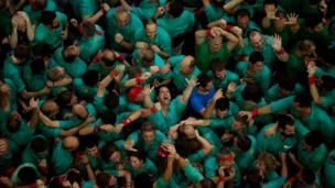 "Members of the ""Castellers de Villafranca"" react after completing their human tower during the 26th Human Tower Competition in Tarragona, Spain, on Sunday, Oct. 2, 2016."