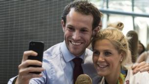 Olympic hockey player Georgie Twigg (right) of Team Great Britain (GB) is greeted as she arrives back in London