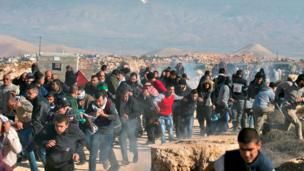 Palestinian protestors clash with Israeli security forces in Qusra village, south of the West Bank city of Nablus