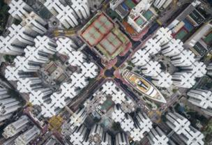 """This aerial image of Hong Kong won Andy Yeung second place. It was inspired by the the Kowloon Walled City, a notoriously dense city that was demolished in the 1990s. """"If you look hard enough, you will notice that the city is not dead,"""" he said. """"Part of it still exists.... I hope this series can get people to think about claustrophobic living in Hong Kong from a new perspective."""""""