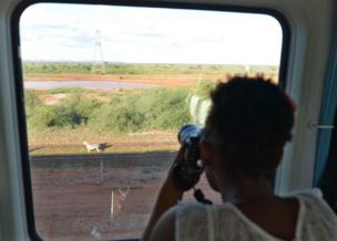 It takes four-and-a-half hours to get from Mombasa to Nairobi, compared to nine hours by bus or 12 hours on the previous railway. The railway passes through some of Kenya's famed national parks, where this woman photographed a zebra.