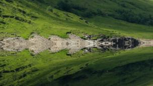 This seamless reflection was photographed at Loch Mullardoch by Rory Dutton during a kayak trip