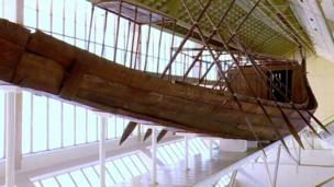 A restored boat that was one of a pair buried in pits next to Pharaoh Khufu final resting place