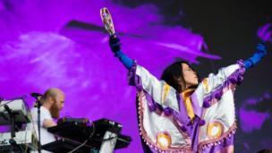 Yukimi Nagano, lead singer of Little Dragon, playing a tambourine