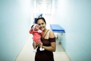 Irene, 23, a Venezuelan woman from Santa Elena city, holds her six-day-old baby Ashlei at a maternity hospital in Boa Vista, Roraima state, Brazil 21 August 2018