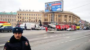 Emergency vehicles and a helicopter are seen at the entrance to Tekhnologichesky Institut metro station in Saint Petersburg on April 3, 2017