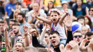 A young girl leads the cheers as Ed Sheeran performs during the first day of BBC Music's Biggest Weekend in Swansea