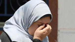 An unidentified woman reacts as she waits for news about the vanished EgyptAir plane, outside the Egyptair in-flight service building at Cairo International Airport, Egypt May 19, 2016.