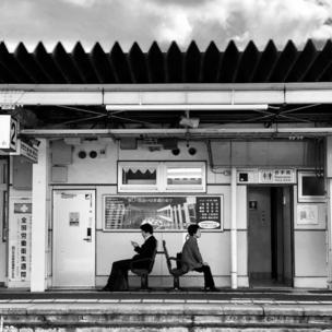 Waiting at a train station in Japan