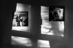 Wedding photos on a bedroom wall